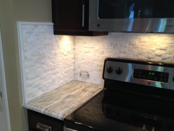 1x2 split faced bianca venato tile backsplash in tampa for Split face travertine kitchen backsplash